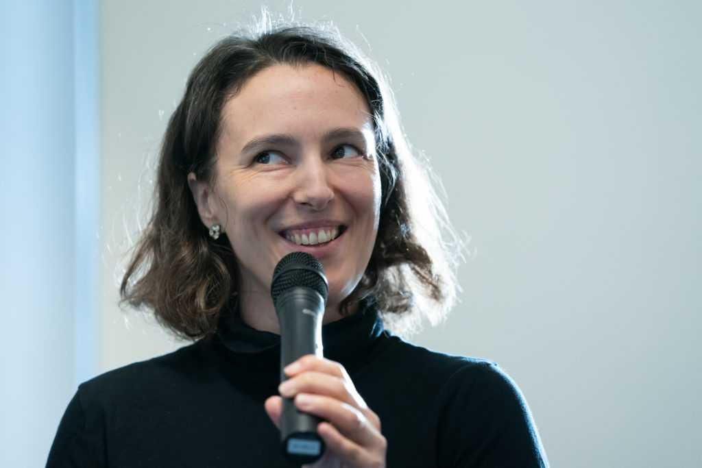 Lotte Schlegel smiling holding microphone